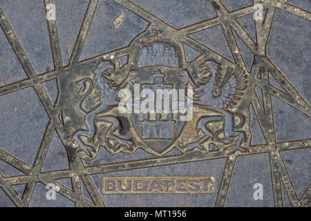 Coat of arms and name of the city on a metal sewer hatche in Hungary, 2018 Budapest - Stock Photo