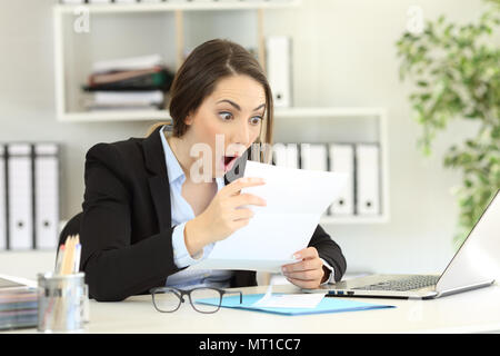Amazed office worker reading good news a letter