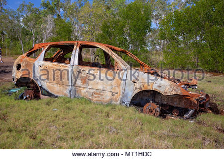 A rusted car wrecked and abandoned amongst the mangroves - Stock Photo