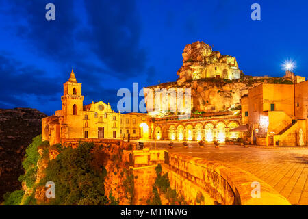 Matera, Sasso Caveoso, Italy: Night view of the San Pietro Caveoso - Stock Photo