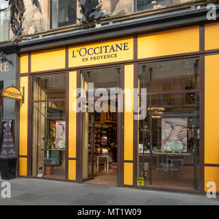 Frontage and open entrance to a shop branch of L'Occitane en Provence, a French / International chain of beauty, fragrance and home products; Glasgow - Stock Photo