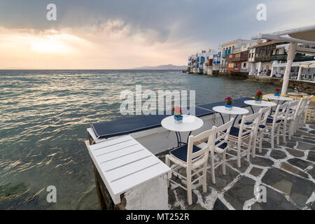 MYKONOS, GREECE - MAY 2018: Sunset view from the embarkment cafe of Little Venice district in Mykonos Chora town, Greece - Stock Photo