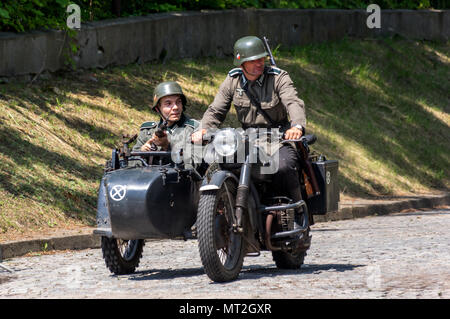 Warsaw, Poland - May 27th, 2018: Re-enactors recreate a battle between Polish and German troops during the the 1939 Defensive War. The German invasion of Poland began at 4.45 a.m. on September 1, 1939. More than 1.5 million German troops invaded Poland, the German Air Force (Luftwaffe) bombed Polish airfields and German warships and U-boats (Kriegsmarine) attacked Polish naval forces in the Baltic Sea. On September 3, Britain and France declared war on Germany, initiating World War II. - Stock Photo