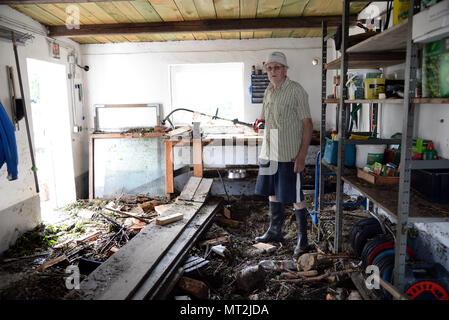 28 May 2018, Germany, Herrstein: Ulrich Schaefer standing in his flood-damaged garage after flooding in Herrstein (Kreis Birkenfeld). Photo: Harald Tittel/dpa - Stock Photo