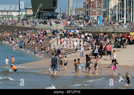 Young children playing in the sea at Blackpool, Lancashire. UK Weather.  28th May, 2018.  Bright sunny start to the day at the coast as holidaymakers and tourists enjoy the amenities and attractions on the seafront promenade in warm summer sunshine. Credit:MediaWorldImages/AlamyLiveNews - Stock Photo