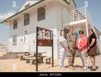 (From left) Danya Cheek, medical support assistant, Addiction Medicine Intensive Outpatient Program (AMIOP), Maj. R. Joel Bush, addiction medicine physician, Gisela Carter, clinical chief, and Soledad Apodaca, psychology technician, stand in front of the AMIOP, which opened its doors to service members at Fort Bliss, July 5. - Stock Photo