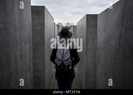 Berlin, Germany - April 3, 2017: Woman on the Memorial to the Murdered Jews of Europe in Berlin - Stock Photo