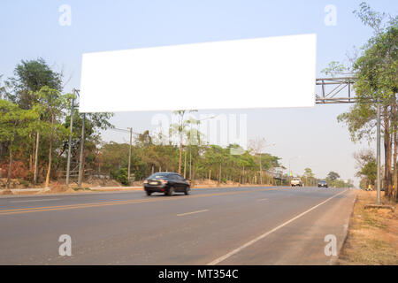 Blank white freeway sign over the road - Stock Photo
