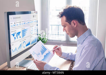 Digital marketing analytics technology with metrics and key performance indicators dashboard on computer screen, person analyzing data chart and adver - Stock Photo