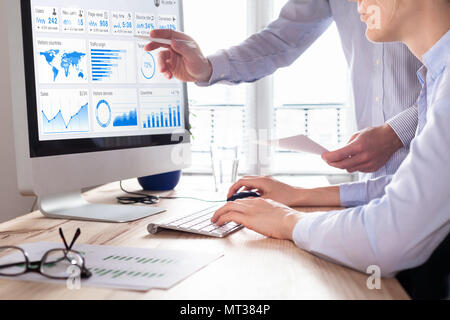 Team of business people discussing digital marketing metrics report and return on investment strategy for advertisement campaign, data analytics dashb - Stock Photo