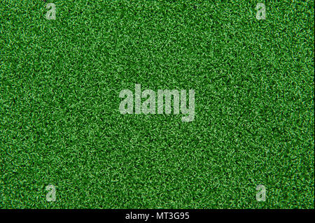 Background texture of synthetic grass or artificial turf used for mini golf and putt putt. - Stock Photo