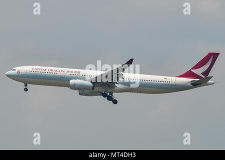Kuala Lumpur, Malaysia - May 3, 2018. An Airbus A330-300 airplane of Cathay Dragon landing at Kuala Lumpur International Airport (KLIA). - Stock Photo