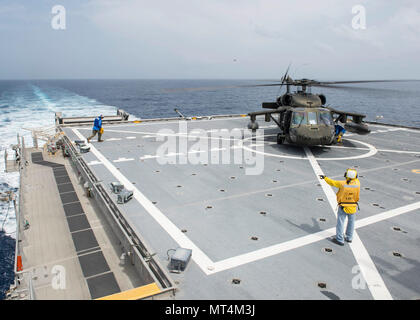 170726-N-YM856-077 CARIBBEAN SEA (July 26, 2017) Personnel assigned to expeditionary fast transport USNS Spearhead (T-EPF-1) conduct helicopter deck landing qualifications during Southern Partnership Station-Expeditionary Fast Transport 2017. SPS-EPF 17 is a U.S. Navy deployment executed by U.S. Naval Forces Southern Command/U.S. 4th Fleet, focused on subject matter expert exchanges with partner nation militaries and security forces in Central and South America. (U.S. Navy Combat Camera photo by Mass Communication Specialist 2nd Class Brittney Cannady) - Stock Photo