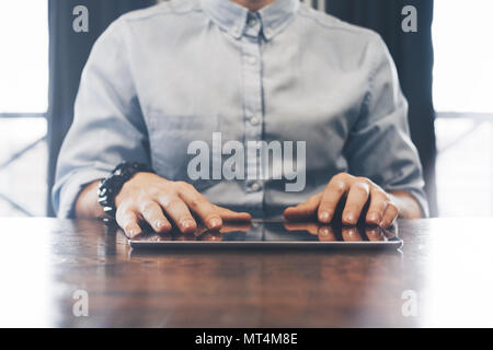 Сlose-up photo of working businessman on  modern tablet. Businessman working on a tablet, hands and fingers closeup. Concept of work behind electronic - Stock Photo