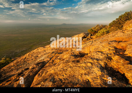 Evening light on Frenchman Peak in Cape Le Grand National Park. - Stock Photo