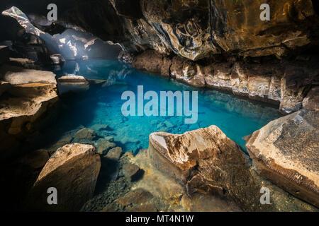 Small lava cave of Grjótagjá. - Stock Photo