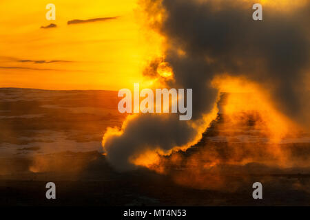 Sunrise at the geothermal area of Namafjall Hverir. - Stock Photo