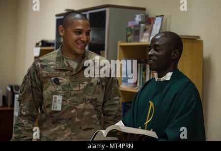 Staff Sgt. Christopher Rodriguez, 455th Air Expeditionary Wing chaplain assistant, and Chaplain (Capt.) John Appiah, 455th AEW, discuss a religious service at Hamid Karzai International Airport, Kabul, Afghanistan, July 23, 2017. Religious support teams provide spiritual support to all members and find ways to meet the needs of individuals who do not have the resources to practice their faith in a deployed location. (U.S. Air Force photo by Staff Sgt. Benjamin Gonsier)
