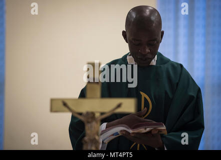Chaplain (Capt.) John Appiah, 455th Air Expeditionary Wing, recites a passage during a religious service at Hamid Karzai International Airport, Kabul, Afghanistan, July 23, 2017. Religious support teams from Bagram Airfield visit six different locations in Afghanistan where a chaplain is not deployed. (U.S. Air Force photo by Staff Sgt. Benjamin Gonsier)