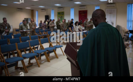 Chaplain (Capt.) John Appiah, 455th Air Expeditionary Wing, preaches during a religious service at Hamid Karzai International Airport, Kabul, Afghanistan, July 23, 2017. Religious support teams provide spiritual support to all members and find ways to meet the needs of individuals who do not have the resources to practice their faith in a deployed location. (U.S. Air Force photo by Staff Sgt. Benjamin Gonsier)