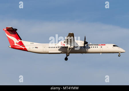 QantasLink De Havilland Canada DHC-8-402Q VH-QOR regional airliner on approach to land at Melbourne International Airport. - Stock Photo