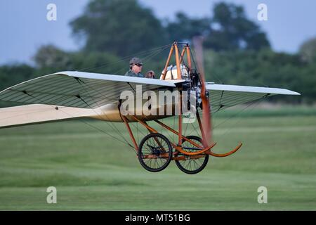 1910 Deperdussin flying at Old Warden Aerodrome - Stock Photo