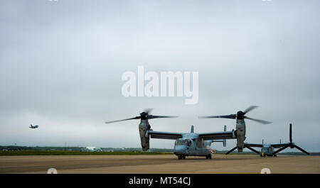 U.S. Marine Corps MV-22 Ospreys, assigned to the Marine Medium Tiltrotor Squadron 262 in Okinawa, Japan, prepare to takeoff at Misawa Air Base, Japan, July 31, 2017. The VMM-262 squadron were temporarily on-station for various certifications for the upcoming joint aircraft training relocation, Exercise Northern Viper 2017. The exercise is scheduled to begin Aug. 10 and is designed to enhance bilateral defense capabilities between U.S. and Japan. (U.S. Air Force photo by Staff Sgt. Deana Heitzman) - Stock Photo