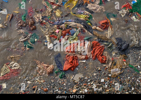 Top shot of extremely dirty ocean water next to the Gateway of India in Mumbai. - Stock Photo
