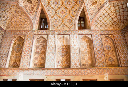 Oriental ornamented wall inside of Ali Qapu Palace, Esfahan, Iran. - Stock Photo
