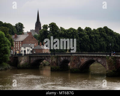 Old Dee Bridge over River Dee, with Parish Church of Saint Mary in the background, in Chester, England, UK. - Stock Photo