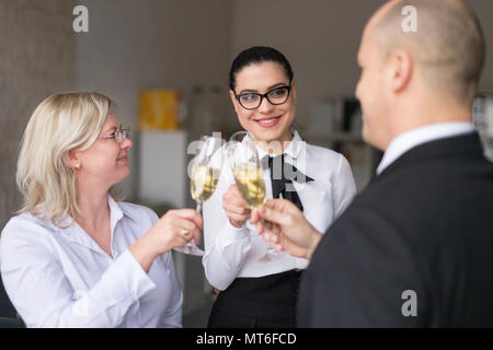 Loyal employee advancement in career in office, cheers with champagne - Stock Photo