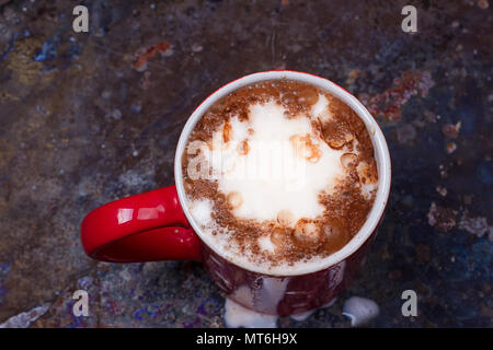 Hot chocolate with marshmallows on grunge dark table - Stock Photo