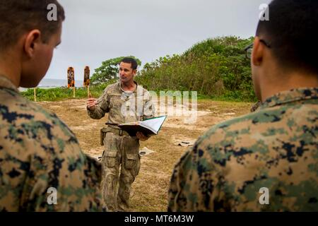 New Zealand Army Sgt. Maj. Paul Buckley, company sergeant major for delta company, explains to U.S. Marines with 3rd Battalion 4th Marines attached to Task Force Koa Moana 17, weapon safety rules prior to participating on a live fire range during Exercise TAFAKULA, on Tongatapu Island, Tonga, July 21, 2017. Exercise TAFAKULA is designed to strengthen the military-to-military, and community relations between Tonga's His Majesty's Armed Forces, French Army of New Caledonia, New Zealand Defense Force, and the United States Armed Forces.  (U.S. Marine Corps photo by MCIPAC Combat Camera Lance Cpl.