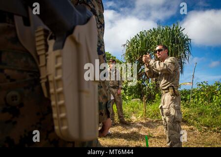 New Zealand Army Sgt. Maj. Paul Buckley, company sergeant major for delta company, shows U.S. Marines with 3rd Battalion 4th Marines attached to Task Force Koa Moana 17, how to properly hold the glock 17 during Exercise TAFAKULA, on Tongatapu Island, Tonga, July 21, 2017. Exercise TAFAKULA is designed to strengthen the military-to-military, and community relations between Tonga's His Majesty's Armed Forces, French Army of New Caledonia, New Zealand Defense Force, and the United States Armed Forces.  (U.S. Marine Corps photo by MCIPAC Combat Camera Lance Cpl. Juan C. Bustos)