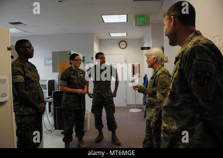 (LEFT TO RIGHT) Petty Officer 3rd Class Anthony Adams, a field medic; Lt. Cmdr. Erin Millea, a general dentist; and Petty Officer 1st Class Christopher McKeehan, a field medic, share their mission experiences with Maj. Gen. Mary Link, commanding general for Army Reserve Medical Command, and Maj. John Longley, 7221st Medical Support Unit's officer in charge for the Round Valley Indian Health Service Innovative Readiness Training mission.  12 U.S. Army Reserve Soldiers are working alongside the three Sailors from 4th Medical Bn., 4th Marine Logistics Group, U.S. Marine Corps Forces Reserve in pa - Stock Photo