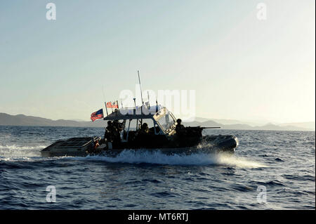 Coast Guardsmen from Port Security Unit 305 aboard a 32-foot Transportable Port Security Boat patrol the waters off the coast of Guantanamo Bay, Cuba, Wednesday, July 19, 2017. PSUs are reserve-staffed units who train in preparation for deployments capable of conducting joint operations worldwide in support of the Department of Defense. U.S. Coast Guard photo by Petty Officer 2nd Class Matthew S. Masaschi - Stock Photo