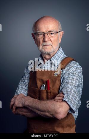 studio portrait of senior carpenter - Stock Photo