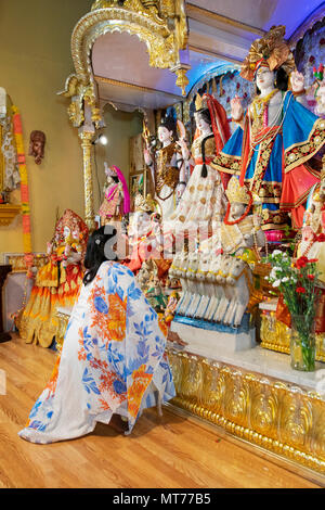 Portrait of a Hindu worshipper at the alter at the Shri Lakshmi Narayan Mandir  temple in Richmond Hill, Queens, New York. - Stock Photo