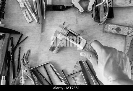 black and white many different tools in mess - Stock Photo