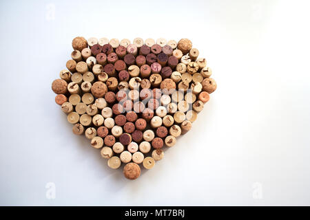 Wine corks diamond shaped composition isolated on white background from a high angle view - Stock Photo