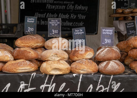Artisan / Craft bread for sale on a market stall in a town centre event - Horsham, West Sussex, UK. - Stock Photo
