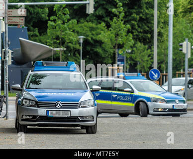 Two German police cars with grey and blue markings waiting to be used at Maschsee in Hanover, Germany, in May 2018 - Stock Photo