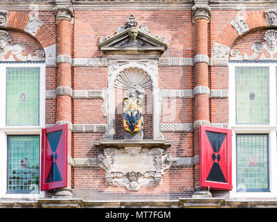 City arms on facade of town hall in historic old town of Bolsward, Friesland, Netherlands - Stock Photo