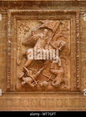 San Millan de la Cogolla, La Rioja, Spain. Yuso Monastery. Relief of Saint Emilian the Moor-Slayer by Spanish sculptor Diego Lizarraga, 1661-1665. Baroque portico, detail. - Stock Photo