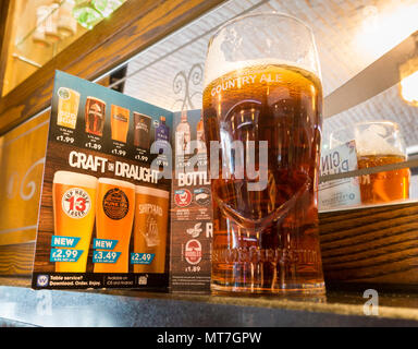 Pint of craft beer in front of menu in JD Wetherspoon`s pub in north east England. UK - Stock Photo