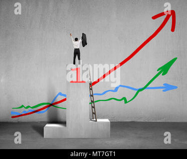 Cheered businessman standing on podium with 3 trends in concrete background - Stock Photo