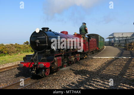 Steam locomotive Hercules in its fine red livery on the Romney, Hythe & Dymchurch steam railway, Kent - Stock Photo