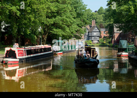 The Packet House is seen across the Bridgewater Canal in Worsley, Salford, Greater Manchester, UK. - Stock Photo