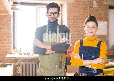 Two Modern Artisans Posing in Workshop - Stock Photo