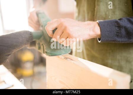 Handsome Carpenter Working in Sunlight - Stock Photo